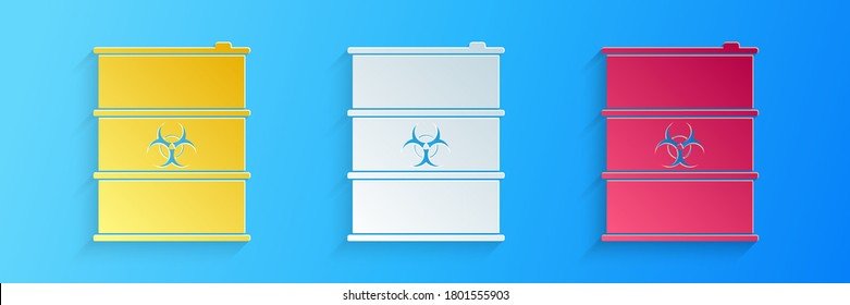 Paper cut Biological hazard or biohazard barrel icon isolated on blue background. Radioactive garbage emissions, danger of ecological disaster. Paper art style. Vector.