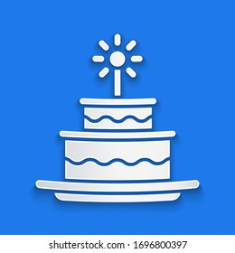 Paper cut Cake with burning candles icon isolated on blue background. Happy Birthday. Paper art style. Vector Illustration