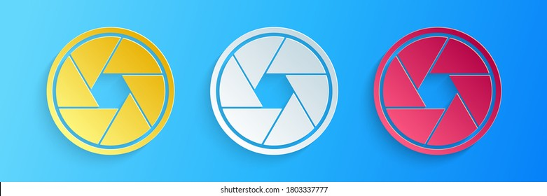 Paper cut Camera shutter icon isolated on blue background. Paper art style. Vector.