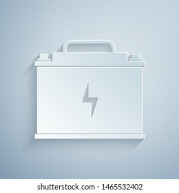 Paper cut Car battery icon isolated on grey background. Accumulator battery energy power and electricity accumulator battery. Lightning bolt. Paper art style. Vector Illustration