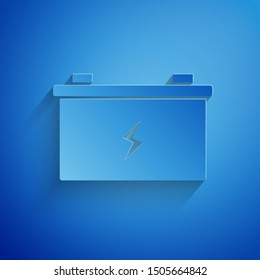 Paper cut Car battery icon isolated on blue background. Accumulator battery energy power and electricity accumulator battery. Paper art style. Vector Illustration