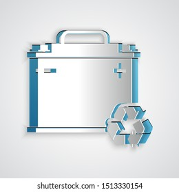 Paper cut Car battery with recycle icon isolated on grey background. Accumulator battery energy power and electricity accumulator battery. Paper art style. Vector Illustration