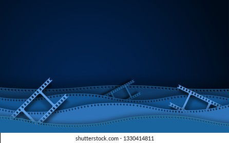 Paper cut cinema decorations with film strip frame isolated on blue background. 35 mm camera diapositive for design layout cinema.Closeup view cinema with space for your text. Abstract paper art style