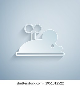 Paper cut Clockwork mouse icon isolated on grey background. Wind up mouse toy. Paper art style. Vector
