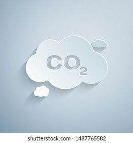 Paper cut CO2 emissions in cloud icon isolated on grey background. Carbon dioxide formula symbol, smog pollution concept, environment concept. Paper art style. Vector Illustration