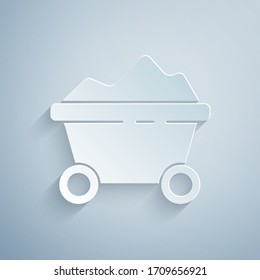 Paper cut Coal mine trolley icon isolated on grey background. Factory coal mine trolley. Paper art style. Vector Illustration