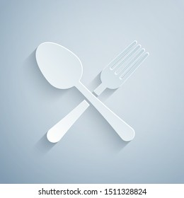 Paper cut Crossed fork and spoon icon isolated on grey background. Cooking utensil. Cutlery sign. Paper art style. Vector Illustration