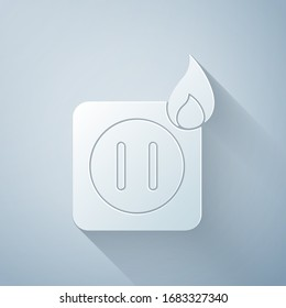 Paper cut Electric wiring of socket in fire icon isolated on grey background. Electrical safety concept. Plug outlet on fire. Paper art style. Vector Illustration
