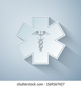 Paper cut Emergency star - medical symbol Caduceus snake with stick icon isolated on grey background. Star of Life. Paper art style. Vector Illustration