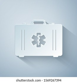 Paper cut First aid kit and Medical symbol of the Emergency - Star of Life icon isolated on grey background. Medical box with cross. Healthcare concept. Paper art style. Vector Illustration