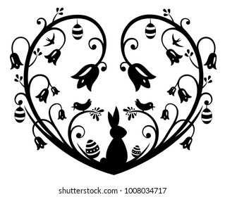 Paper cut heart with Easter bunny, eggs snowdrops and daffodils.