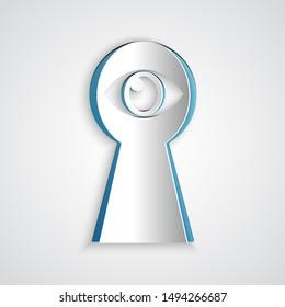Paper cut Keyhole with eye icon isolated on grey background. The eye looks into the keyhole. Keyhole eye hole. Paper art style. Vector Illustration