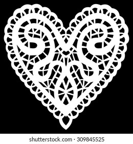 Paper cut lacy heart on black background