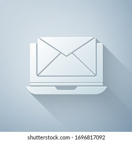 Paper cut Laptop with envelope and open email on screen icon isolated on grey background. Email marketing, internet advertising concepts. Paper art style. Vector Illustration