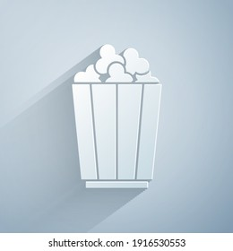 Paper cut Popcorn in cardboard box icon isolated on grey background. Popcorn bucket box. Paper art style. Vector