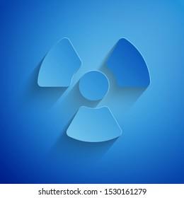 Paper cut Radioactive icon isolated on blue background. Radioactive toxic symbol. Radiation Hazard sign. Paper art style. Vector Illustration