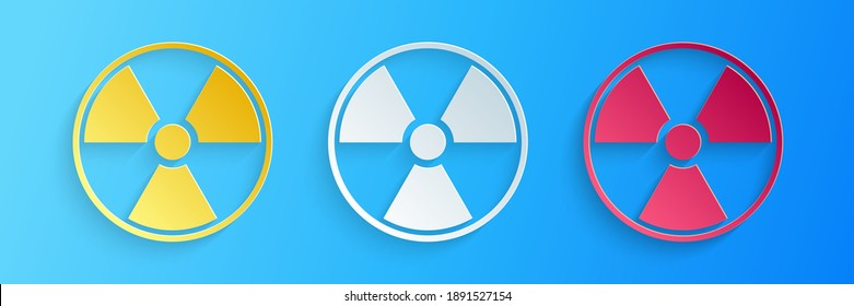 Paper cut Radioactive icon isolated on blue background. Radioactive toxic symbol. Radiation Hazard sign. Paper art style. Vector.