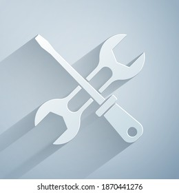 Paper cut Screwdriver and wrench spanner tools icon isolated on grey background. Service tool symbol. Paper art style. Vector