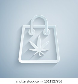 Paper cut Shopping paper bag of medical marijuana or cannabis leaf icon isolated on grey background. Buying cannabis. Hemp symbol. Paper art style. Vector Illustration