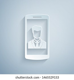Paper cut Smartphone with contact on screen icon isolated on grey background. Incoming call. Human on phone screen. Call contact. Paper art style. Vector Illustration