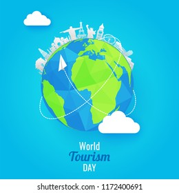 Paper cut style famous monuments of world with earth globe on shiny blue background world tourism day concept.