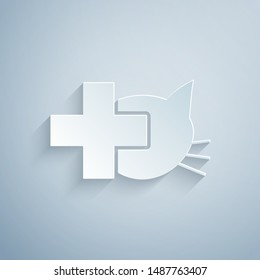 Paper cut Veterinary clinic symbol icon isolated on grey background. Cross with cat veterinary care. Pet First Aid sign. Paper art style. Vector Illustration