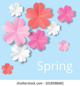 Paper flowers on blue background in origami stale