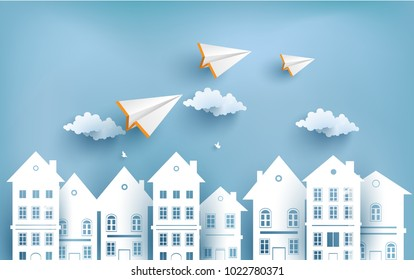 paper plane flying across town. design paper art and crafts