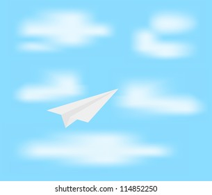 Paper plane on blue sky with clouds