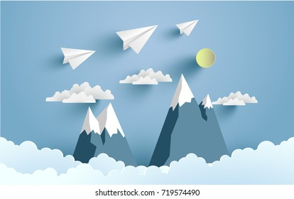 paper planes cross mountains and clouds with beautiful scenery