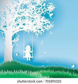 Paper silhouette of girl on swing