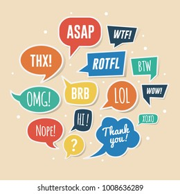 Paper speech bubbles with phrases. ASAP, ROTFL, LOL, BRB, etc.
