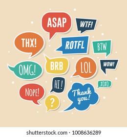 Paper speech bubbles with phrases. ASAP, ROTFL, LOL, BRB, etc.