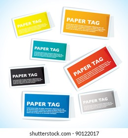 Paper tags with white borders and sticky tape