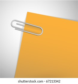 paperclip on the yellow paper