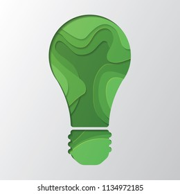 Papercut bulb icon on green background
