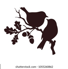 Pare of birds sitting on twig of oak. Decorative vector silhouette.