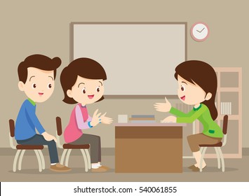 Parent meeting with teacher in classroom.School principal talking to father and mother.
