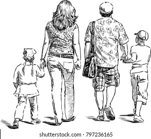 Parents with their kids go for a stroll