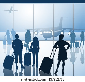 Passengers with luggage in airport