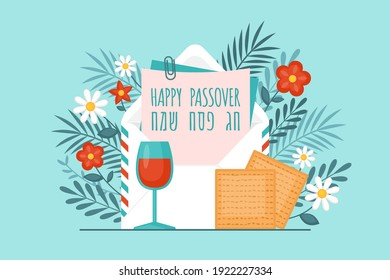 """Passover holiday concept with envelope, matzah. wine glass and flowers. Text in Hebrew: """"Happy Passover"""""""
