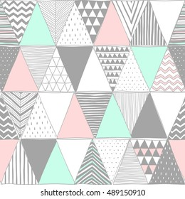 pastel colors vector seamless pattern with triangles. Geometric mosaic art print. Abstract vector background. Creative graphic design template. Wallpaper, fabric, textile, wrapping paper. Hand drawn