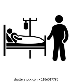 A patient in a hospital ward is resting on a bed with the intravenous fluids