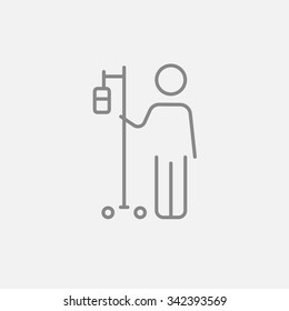 Patient standing with intravenous dropper line icon for web, mobile and infographics. Vector dark grey icon isolated on light grey background.
