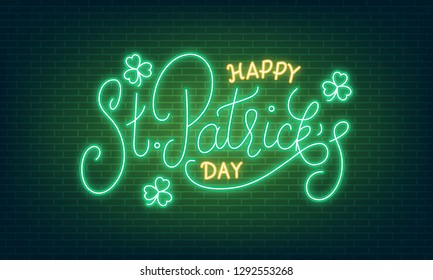 Patricks Day. Neon glowing lettering sign of Happy St. Patrick's Day lettering and clover leaves.
