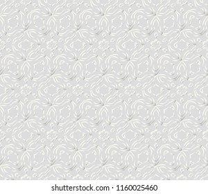 Pattern of abstract geometric flowers. Seamless vector illustration. for design greeting cards, backgrounds, wallpaper. Silver color