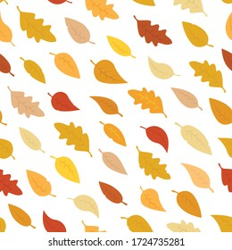 pattern of autumn leaves, orange, yellow, brown fallen leaves on a white background