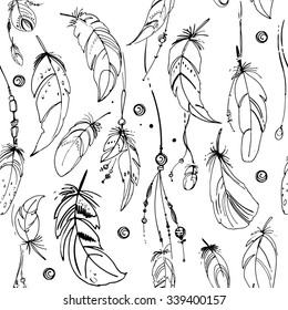 Pattern of ethnic feathers. Ethnic set in native style. Feathers and beads on white background. Vector decorative elements hippie