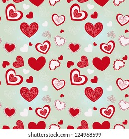 Pattern of red hearts on a blue background