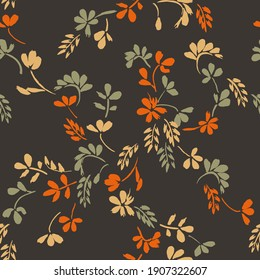 Pattern with small flowers for the fabric. Ditsy floral pattern in brown and orange shades in vector drawing.